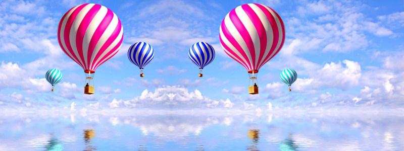 海上热气球蓝天白云背景banner