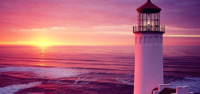 夕阳大海灯塔背景