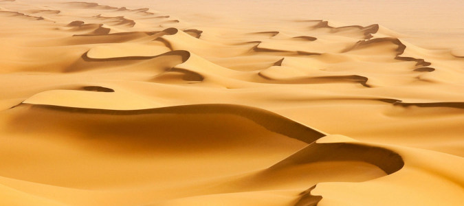 炫酷黄色沙漠质感海报背景高清背景图片素材下载