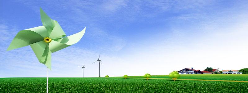 草地上的绿色纸风车背景