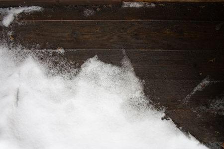 木板上的雪背景