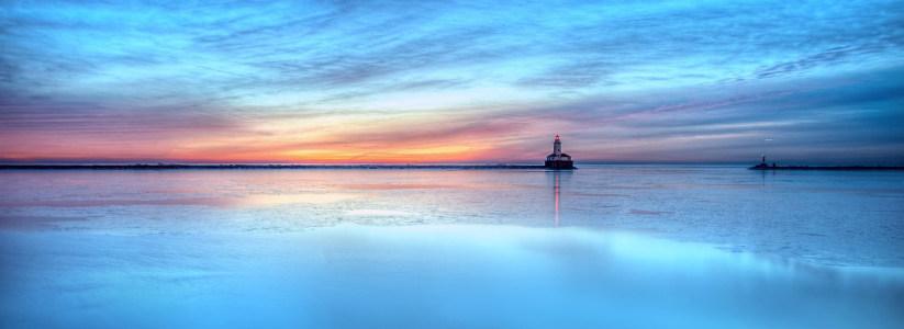 唯美夕阳大海灯塔背景