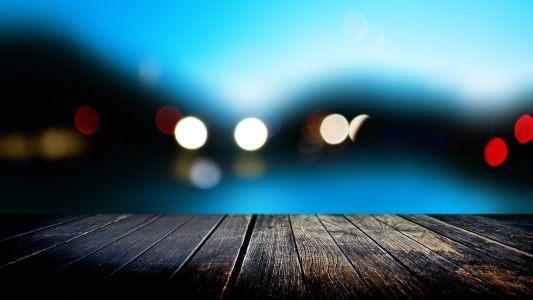 蓝色光斑木板背景